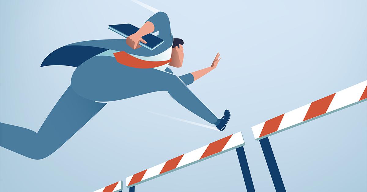 Homme d'affaires sautant au-delà des obstacles