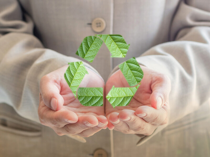 Man holding recycling symbol